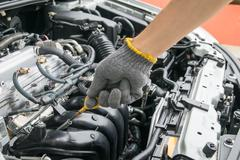 Check the oil level in car engine Stock Photos