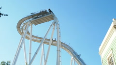 People having fun upside at roller coaster called oblivion at Gardland Stock Footage