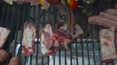 Cooking Meat on a Charcoal BBQ Barbecue Grill Stock Footage