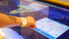 Children hands type slide an educational geographical multimedia table display Stock Footage