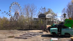 An abandoned and graffiti covered amusement park presents a spooky and haunted Stock Footage