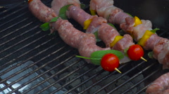 Skewers of Meat and vegetables on a Charcoal BBQ Barbecue Grill Stock Footage