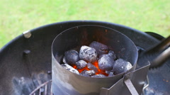 Stoking Fire with Charcoal on a BBQ Barbecue Grill Stock Footage