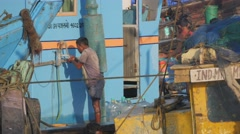 Man washing on fisherman boat,Mumbai,India Stock Footage