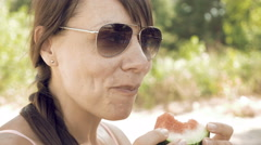 Smiley woman eats an watermelon outdoors on summer Stock Footage