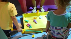 Children play on indoors playground with toys in cognitive museum for kids Stock Footage