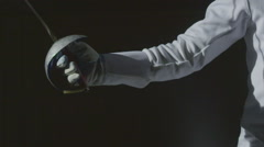 Fencing Closeup on black background Stock Footage