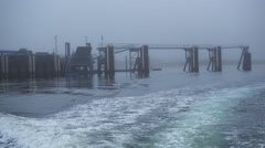 POV-Aft view boat departing dock on grey foggy day Gustavus AK Stock Footage
