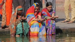 Women praying on Ram Kund ghat at sacred Godavari river,Nashik,India Stock Footage
