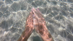 Man diving in clear water Stock Footage