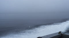 View from speeding boat flat grey foggy horizon Stock Footage
