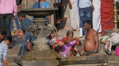 Pilgrims with ritual at fountain on Ram Kund ghat,Nashik,India Stock Footage