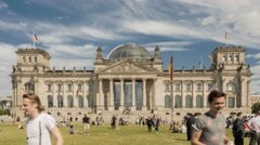 Time Lapse of front exterior of Reichstag with people relaxing on the grass Stock Footage