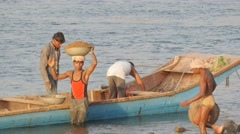 Worker unloading sand from boat on head,Omkareshwar,India Stock Footage