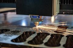 CNC Laser cutting of metal, modern industrial technology. . Kuvituskuvat