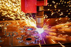 CNC Laser plasma cutting of metal, modern industrial technology. . Stock Photos