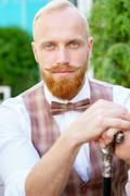 Portrait of stylish blonde man with red beard Stock Photos
