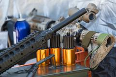 Ammunition to arms closeup Stock Photos