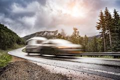Caravan car trailer travels on the highway. Stock Photos