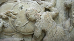 Stone relief representation of greek goddess Athena in the Gigantomachy battle Stock Footage