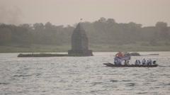 Pilgrims on boat to Baneshwar temple in Narmada river,Maheshwar,India Stock Footage