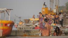 Pilgrims on ghats washing in morning,Maheshwar,India Stock Footage
