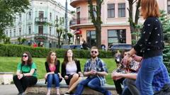 4K .Young modern men and girls sing on city street .Ukraine, Chernivtsi Stock Footage