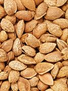 Unpeeled Almonds Nuts Background Stock Photos