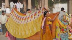 Women drying sarees on ghat,Maheshwar,India Stock Footage