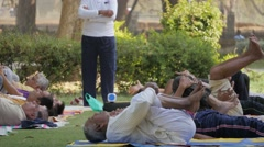 Men doing yoga in Lal Bagh park with teacher,Indore,India Stock Footage