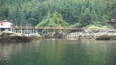 POV from boat motoring slowly past bridge rocks Elfin Cove AK Stock Footage