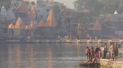 Pilgrims washing in Shipra river at Ram Ghat,Ujjain,India Stock Footage