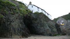 Cave under a house in a traditional English fishing village Stock Footage