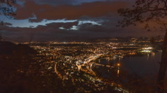 4K time lapse of a city at a lake during night with clouds and stars Stock Footage