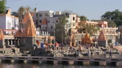 Pilgrims walking across bridge to Ram Ghat,Ujjain,India Stock Footage