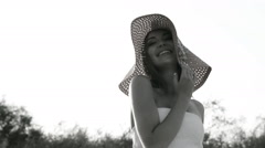 Girl posing on the shore in a hat Stock Footage