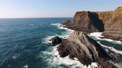 Waves and the picturesque cliff aerial view Portugal Stock Footage