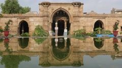 Ahmed Shah's mosque with reflection in pool,Ahmedabad,India Stock Footage