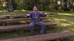 Hiker with walking sticks take breathing exercises Stock Footage