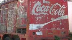 An old and weathered Coca Cola delivery truck sits abandoned. Stock Footage