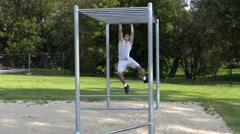 Young athlete training hands on gymnastic bars Stock Footage