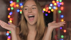 Confetti raining down on a beautiful young woman in slow motion Stock Footage