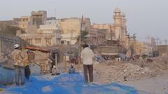 Men fixing net in harbour,Porbandar,India Stock Footage