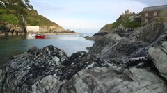 Fishing boat and coarse rocks in Cornwall Stock Footage