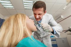 Woman seeing a dentist Stock Photos