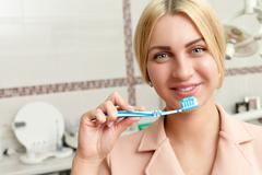 Woman with tooth brush Stock Photos