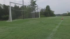 4k Soccer Net Low Flying Aerial At Football Field Stock Footage