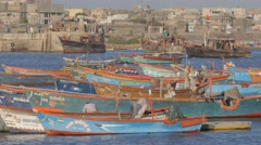 Fishermen boats returning into harbour,Veraval,India Stock Footage
