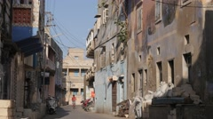 Boy on bicycle through old town,Diu,India Stock Footage