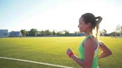 Beautiful young woman exercise jogging and running on athletic track on stadium Stock Footage